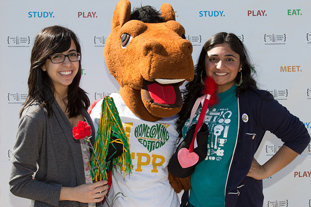 Two students pose with the Billy Bronco mascot