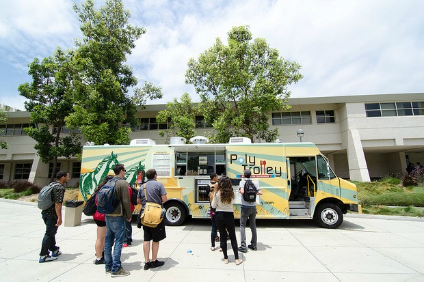 Students line up to eat at the food truck, the Poly Trolley