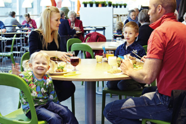 Family eats delicious meal at IKEA as small child  poses adorably for the camera