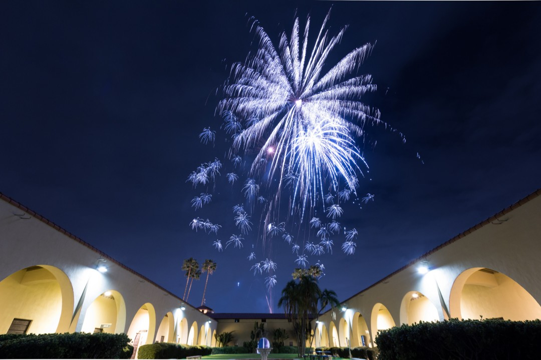 Fireworks explode over University Plaza.