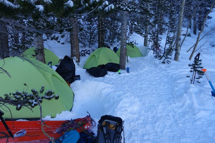 Tents perched on snow-filled mountain