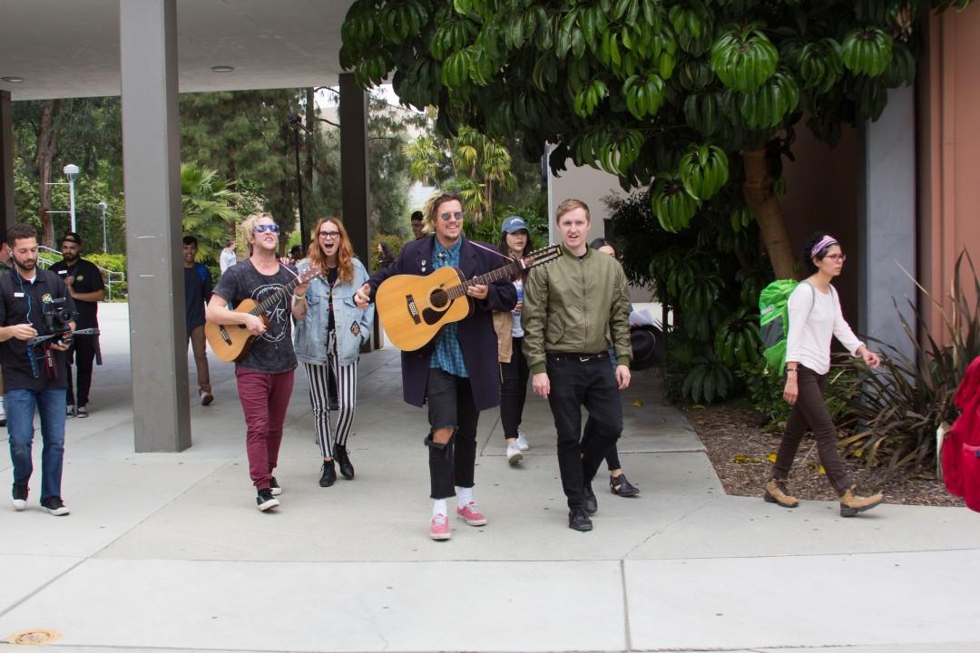 FMLYBND walks to University Theater