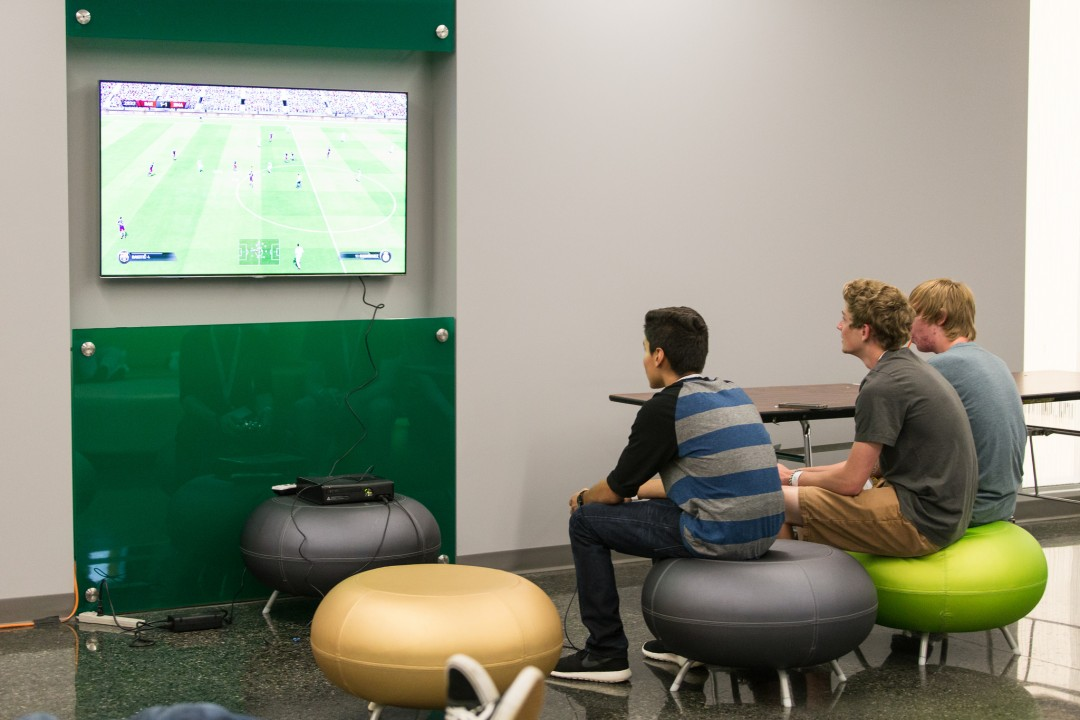 Students enjoying video game inside BRIC