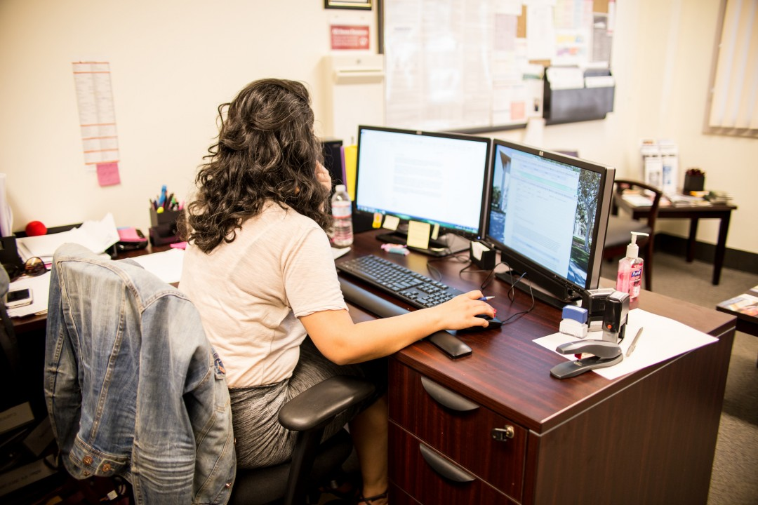 Back view of HR employee on computer