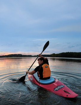 Student kayaking.