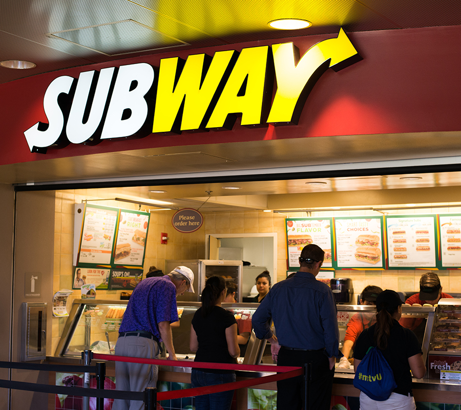Students in line ordering food at Subway