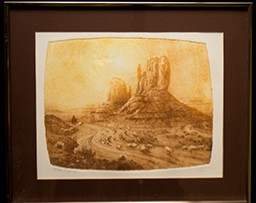 Desert scene with cliffs and a silhouette in the distance