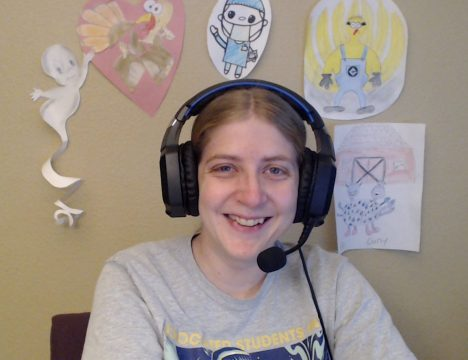 Marissa Engel smiling with headset on