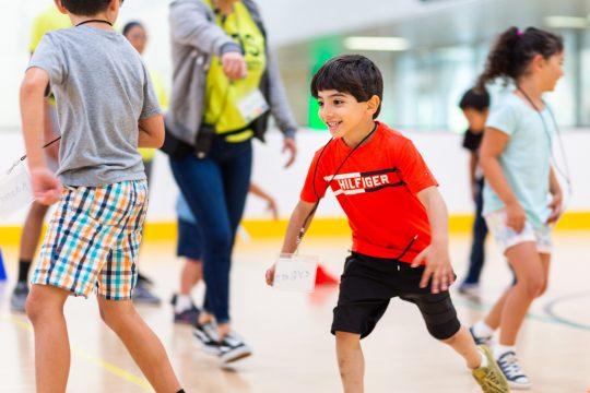 Children running in gym