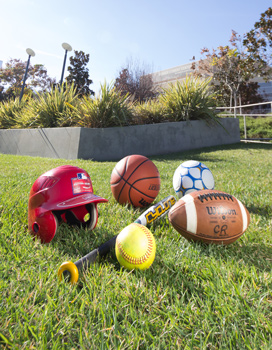 Assorted sports equipment on grass