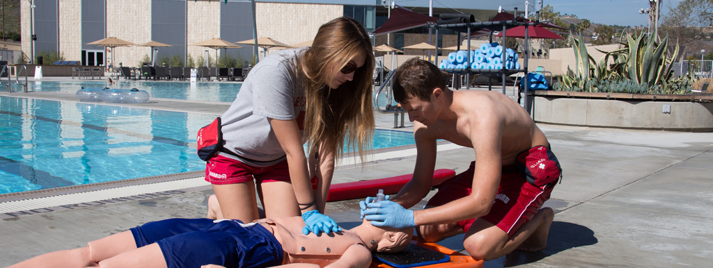 lifeguard training practicing CPR