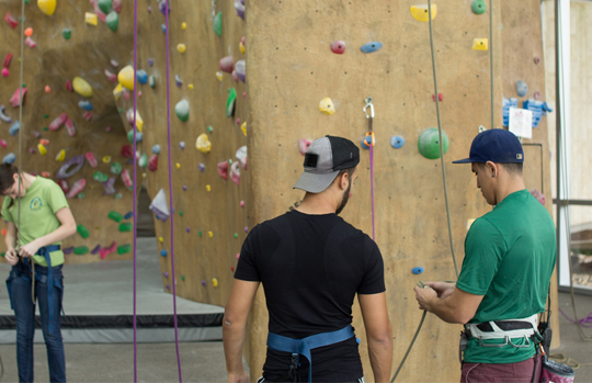 Student getting certified on the rock wall