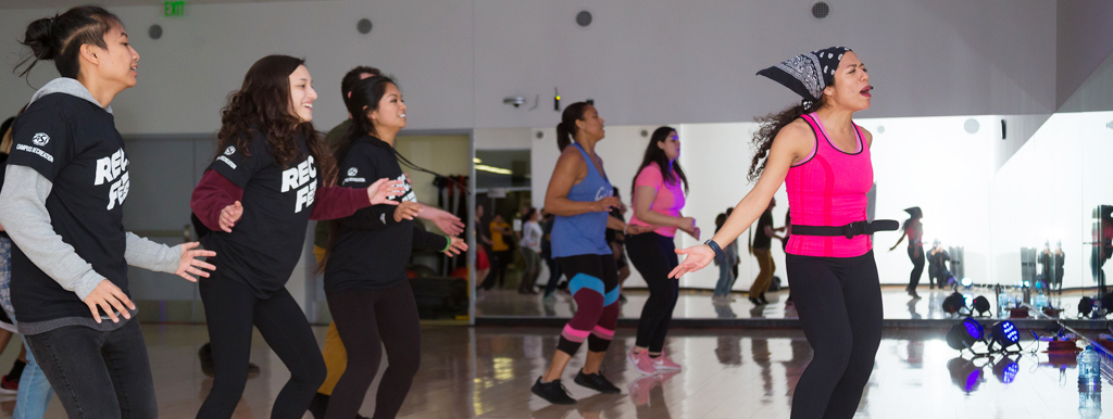Students participating in a zumba class