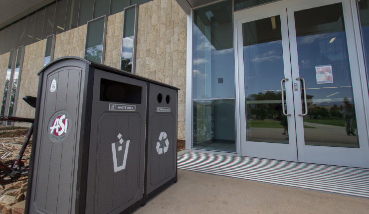 Trash and recycle bins outside the BRIC