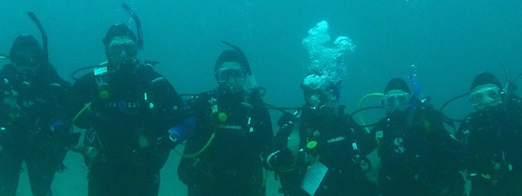 Group of scuba divers lined up