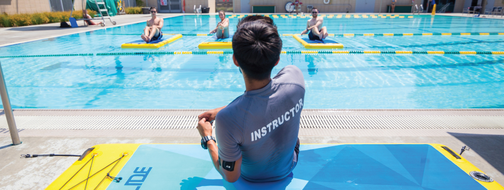 Aquatics instructor teaching students in a Fit Float class