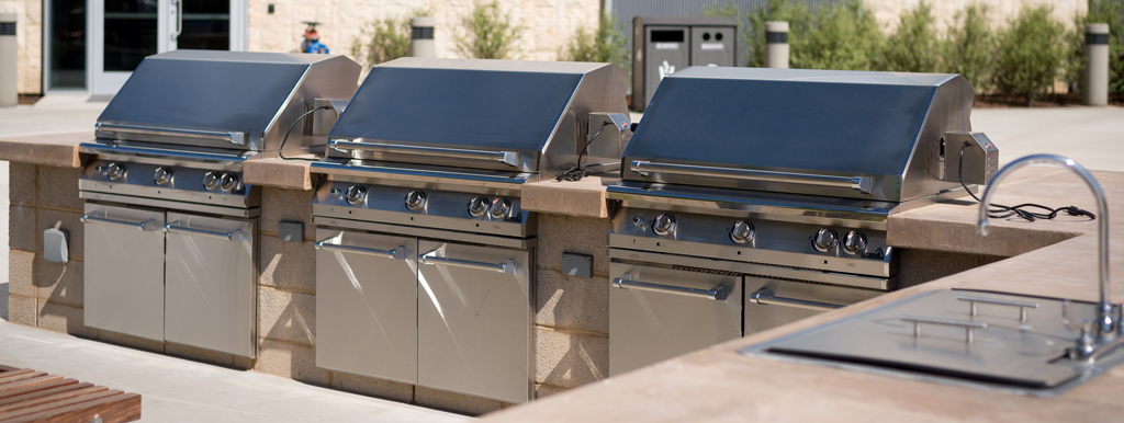 Three grills at the BRIC pool deck