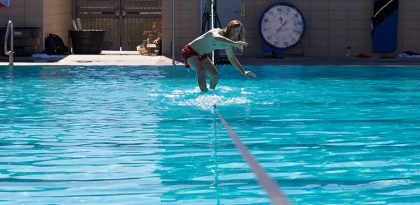 Student slacklining at the BRIC pool