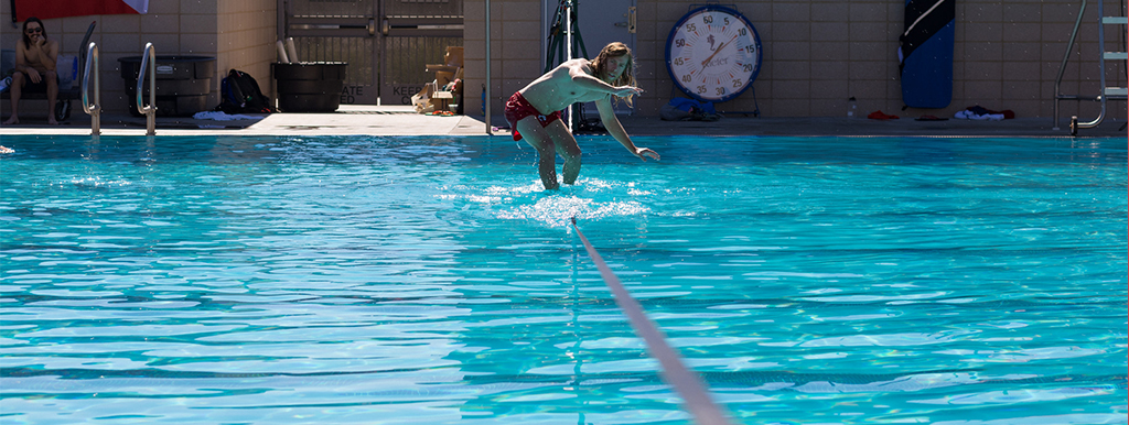 Student slacklining at the BRIC pool