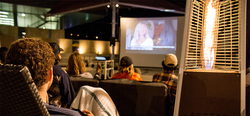 Student watching movie at BRIC Lounge