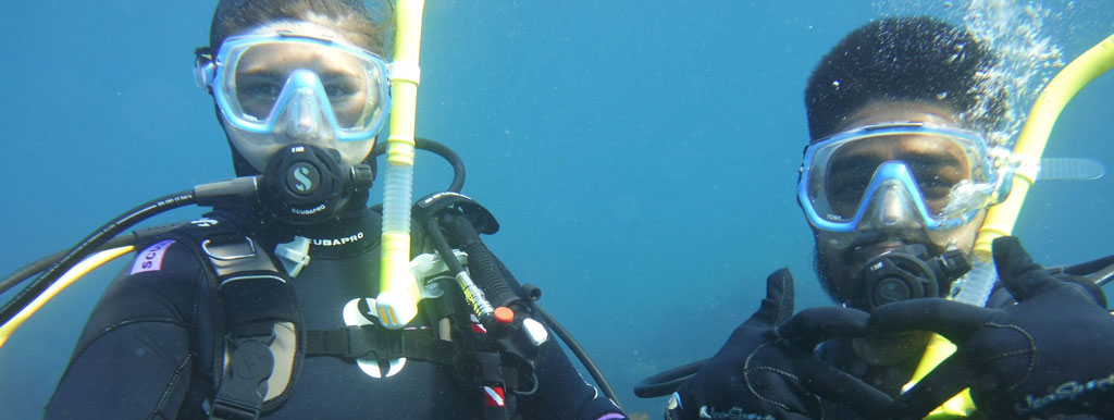 Two scuba divers looking at the camera.
