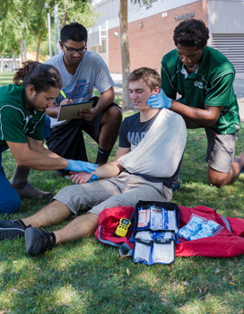 Campus Rec employees giving medical assistance to a member