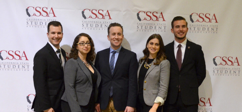 Individuals posing at a CSSA event