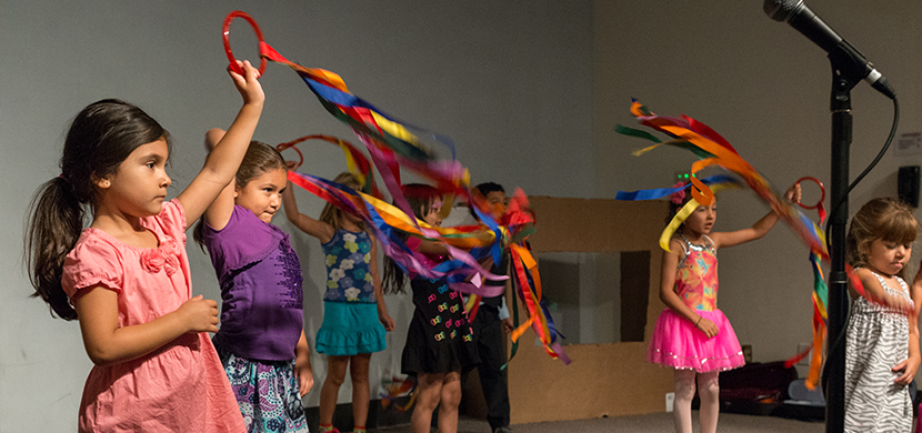 Children dancing with streamers