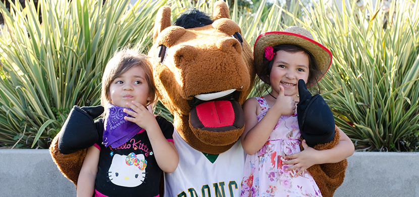 Two children with the Billy Bronco mascot