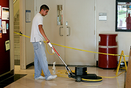 Janitor cleaning the floors