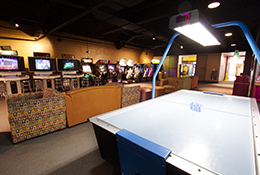 Arcade full of lights and a hockey table
