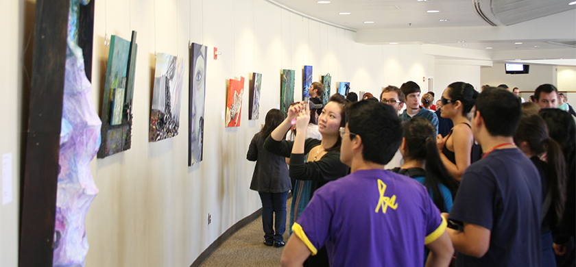 People looking at art pieces being displayed at the Bronco Student Center