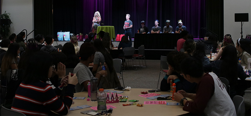 Drag queen leading a bingo event
