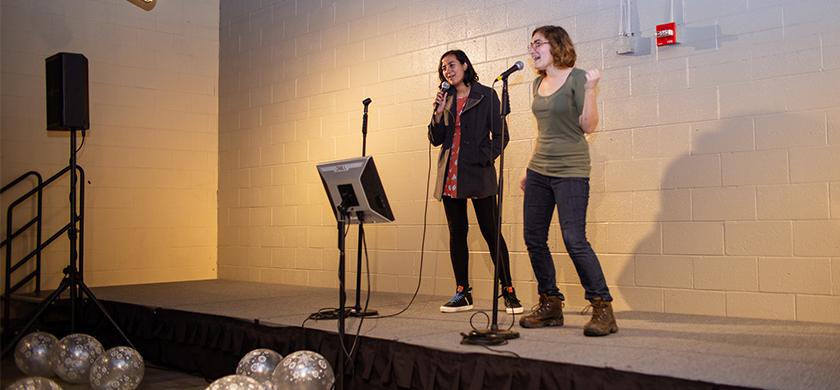 two girls singing during karaoke night