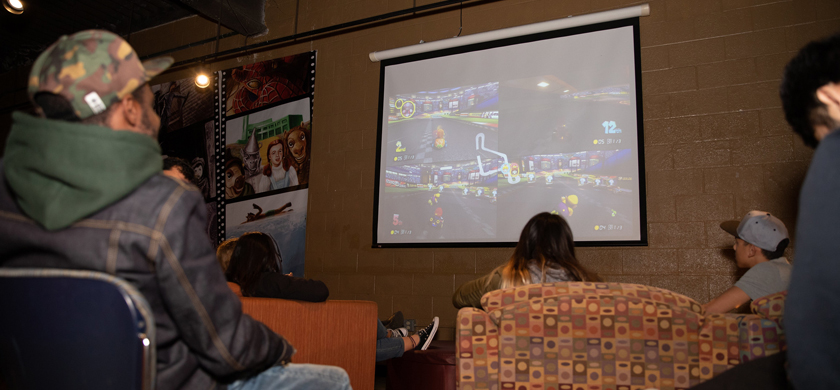 Students playing video games on a projector