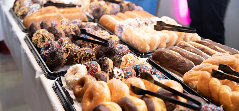 Trays of various flavor donuts
