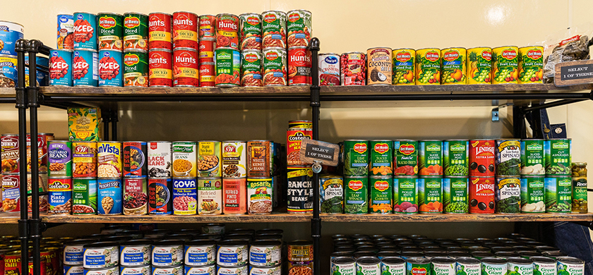 Canned goods displayed on shelves