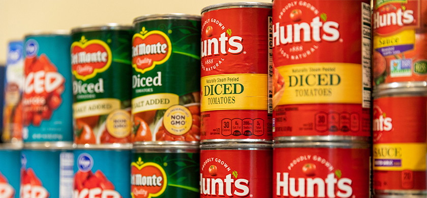 Closeup of canned goods displayed on shelves