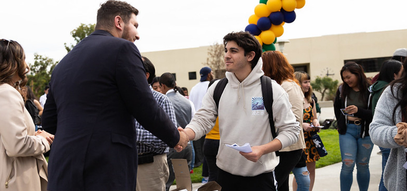 Student shaking hands with another student candidate