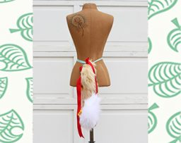 Dress mannequin with a faux fur tail